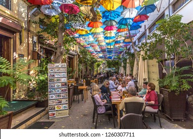 Nicosia, Cyprus - Oct 31st 2018 - Tourists and locals having lunch in a restaurant with colorful umbrellas in top of it in the turkish side of Nicosia in Cyprus