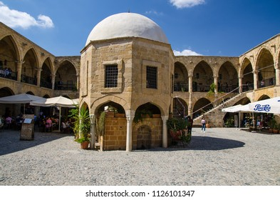 Nicosia, Cyprus - September 24, 2017: Cafes, restaurants and souvenir shops in Caravanserai Buyuk Han (the Great Inn) in Nicosia, Lefkosa, North Cyprus