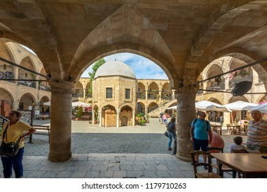 Nicosia (Lefkosa), Cyprus - May 08, 2018: Cafes, restaurants and souvenir shops in Caravanserai (Buyuk Han) the Great Inn in Nicosia, North Cyprus