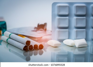 Nicotine chewing gum in blister pack near pile of cigarette. Quit smoking or smoking cessation and lung cancer concept. 31 May : World no tobacco day.