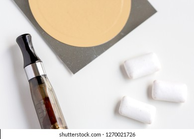 nicotine patch, chewin gum and ecigarette used for smoking cessation isolated on white background