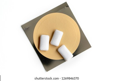 Nicotine patch and chewin gum used for smoking cessation isolated on white background