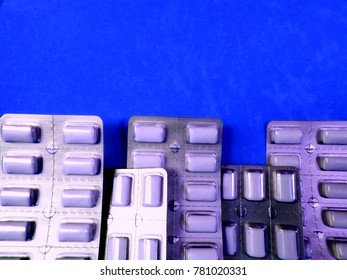 Nicotine tablets on a blue background