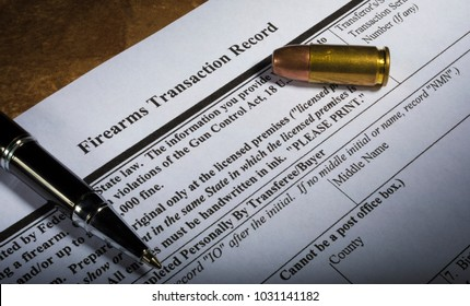 NICS background check form from the FBI with pen and cartridge