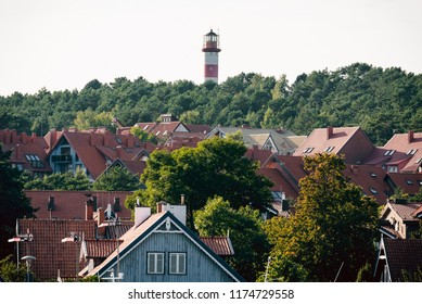 Nida city rooftops and lighthouse on the hill. Lithuania.