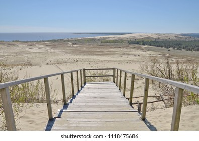 Nida - Curonian Spit and Curonian lagoon. panoramic view of dune, sand. Sea in the background. The Parnidis dune over Nida and the Curonian lagoon. UNESCO World Heritage site