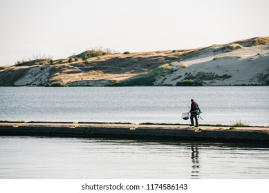 NIDA, CURONIAN SPIT, LITHUANIA - September 3, 2018. Parnidis dunes and fisherman going to catch some fish.
