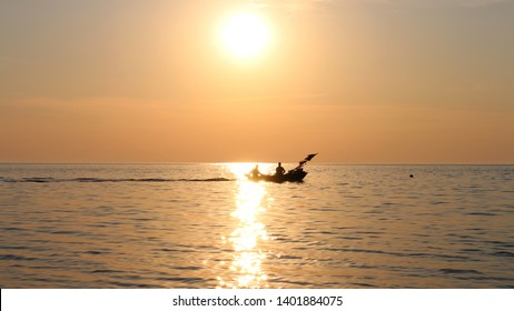 Nida, Lithuania - 05.07.2015, Fishing boat at sunset in the waters of Curonian lagoon.