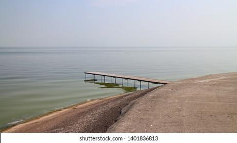 Nida, Lithuania - 05.07.2015, Wooden bridge in a Curonian lagoon.