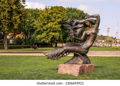 Nida, Lithuania -August 2018: Bronze sculpture of a woman at Nida resort town near Klaipeda in Neringa in the the Baltic Sea on the Curonian Spit in Lithuania.