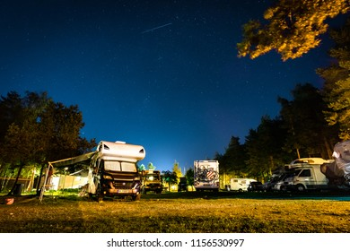 Nida, Lithuania, August 2018: RVs and motorhomes on the campgaoung Nidos kempingas in Nida. Nida is a resort town in Lithuania, the administrative centre of Neringa municipality. Located on the