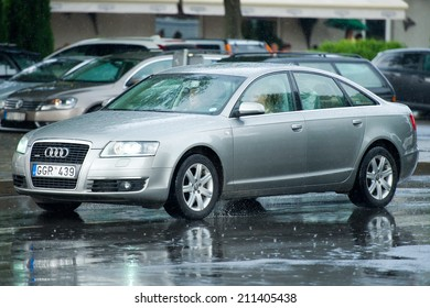 NIDA, LITHUANIA - JULY 14 : Audi a6 Quattro (C6) on July 14, 2014 in Nida, Lithuania. The Audi A6 is an executive mid-size car made by the German automaker Audi AG.