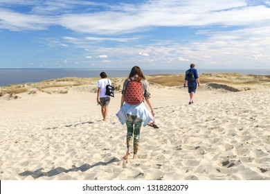 Nida, Lithuania - July 7, 2018: Tourists are walking on Parnidis (parnidzio) sand dune. One the the most beautiful and popular tourist points. Located in Nida, in Curonian Spit. Unesco heritage site.