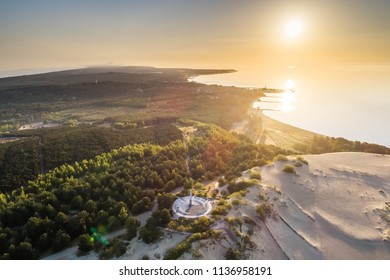 Nida / Lithuania - June 18 2018: Early morning aerial view of sundial constructed on Parnidzio dune in Curonian spit near Nida, Lithuania