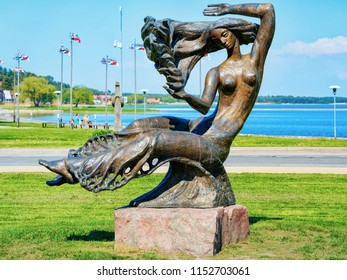 Nida, Lithuania - May 10, 2016: Bronze sculpture of a woman at Nida resort town near Klaipeda in Neringa in the the Baltic Sea on the Curonian Spit in Lithuania.