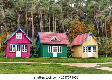 NIDA TOWN, LITHUANIA - 16 OCTOBER 2019: Traditional colorful souvenir houses on the shopping street in the town of Nida. Baltic coast, Lithuania.