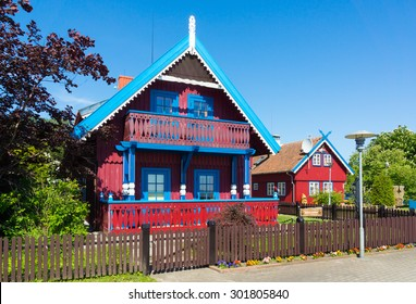 Nida. Traditional fisherman's house in Nida, Lithuania. Nida is a resort town in Lithuania. Located on the Curonian Spit between the Curonian Lagoon and the Baltic Sea. Unesco Heritage.