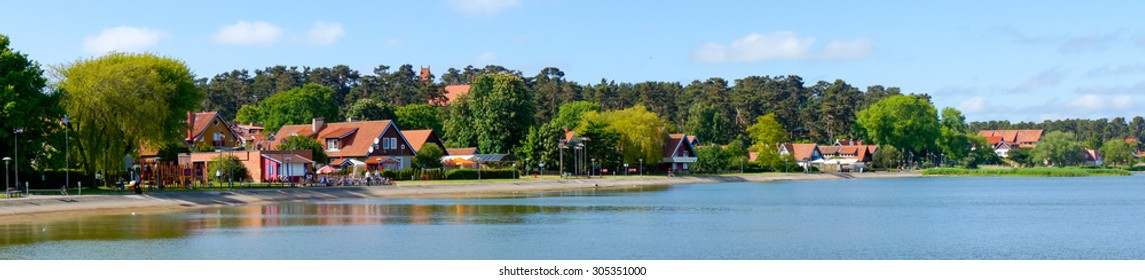 Nida. Traditional fisherman's houses in Nida, Lithuania. Nida is a resort town in Lithuania. Located on the Curonian Spit between the Curonian Lagoon and the Baltic Sea. Unesco Heritage.