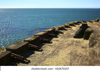 NIEBLA, CHILE - FEBRUARY 2, 2016: Cannons of the Niebla fort with view onto the Pacific Ocean on February 2, 2016 in Niebla, Chile. The fort is part of the Valdivian fort system