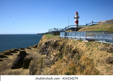 NIEBLA, CHILE - FEBRUARY 2, 2016: Lighthouse and cannons of the Niebla fort, Chile on February 2, 2016. The fort is part of the Valdivian fort system and was declared national monument in 1950.