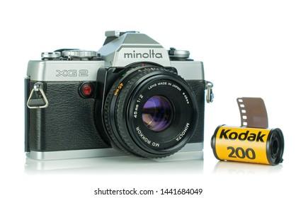 NIEDERSACHSEN, GERMANY April 9, 2019: A Minolta XG2 35mm analog film camera on a white background with Kodak film