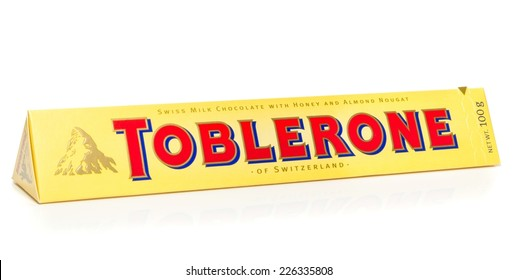 NIEDERSACHSEN, GERMANY OCTOBER 25, 2014: A bar of Toblerone milk chocolate on a white background