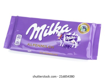 NIEDERSACHSEN, GERMANY SEPTEMBER 12, 2014: A bar of Milka Mondelez Alpenmilch milk chocolate with the purple Milka cow on a white background