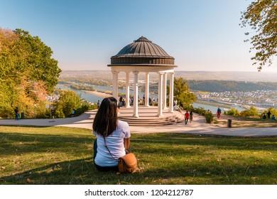 Niederwaldtempel rotunda located in the Niederwald near Rudesheim am Rhein in Hesse, Germany young woman at the park