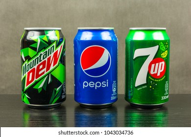 Niedomice, Poland - March 06, 2018: Beverage cans produced by Pepsico - Mountain Dew, Pepsi, 7up.