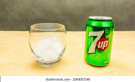 Niedomice, Poland - March 09, 2018: A can of 7up drink and a glass of ice.