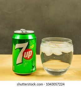 Niedomice, Poland - March 09, 2018: 7up in a glass with ice cubes.