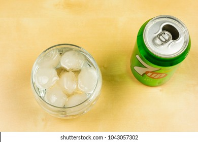 Niedomice, Poland - March 09, 2018: Ice cubes in a glass with 7up. View from above.