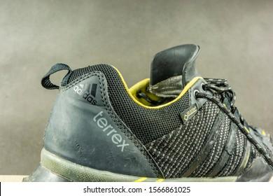Niedomice, Poland - November 21, 2019: Logo - Adidas Terrex- on the approach shoe with Gore-tex membrane.
