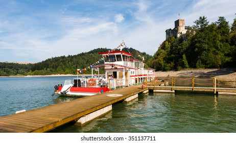 Niedzica, Poland - August 28, 2015: tourist boat on Czorsztynskie lake. Popular way - for many tourists - to get to Czorsztyn castle. Wooden pier for boats is located at the foot of Niedzica Castle