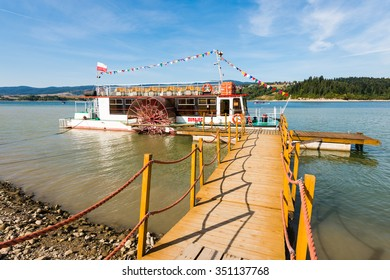 Niedzica, Poland - August 28, 2015: tourist boat - paddle steamer - on Czorsztynskie lake. Popular way - for many tourists - to get to ruins of Czorsztyn castle located on the other side of the lake