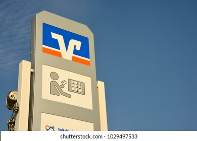 Nienhagen, Lower Saxony / Germany - September 29, 2017: Sign with the logo of the german credit union Volksbank - Raiffeisenbank in Nienhagen, Germany