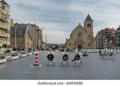Nieuwpoort, Belgium - 11 March 2017: Group of tourists enjoying quiet time in the centre of Nieuwpoort-Bad.