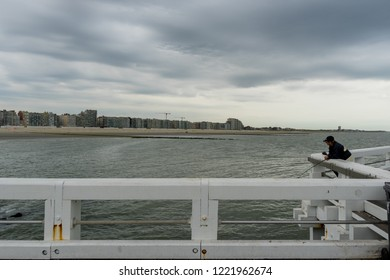 Nieuwpoort, Belgium - August 9, 2018: Man fishing in the harbour of Nieuwpoort West Flanders Belgium