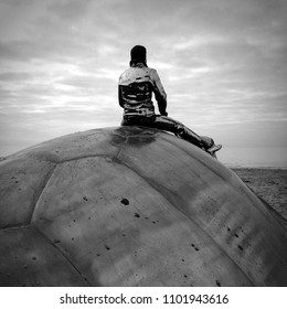 "Nieuwpoort, Belgium - February 16, 2013: Jan Fabre's artwork ""Searching for Utopia"" on the beach of Nieuwpoort, Belgium."