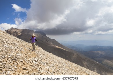 NIGDE, TURKEY - AUGUST 01, 2014: Woman mountainer approaching Alaca route on sunny trail in the Aladaglar mountains
