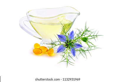 Nigella Sativa (Also Black Caraway) and Black Cumin Oil (Also  Kalonji or Calonji) in Capsules and Glass Dish.  Isolated on White Background.