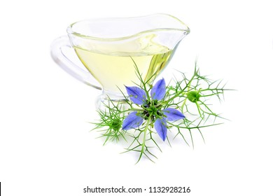 Nigella Sativa and Black Cumin Oil. Also Known as Black Caraway, Kalonji or Calonji. Isolated on White Background.