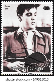 NIGER - CIRCA 1999: A postage stamp printed by NIGER shows image portrait of famous American singer Elvis Presley, circa 1999.