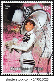 NIGER - CIRCA 1999: A postage stamp printed by NIGER shows image portrait of famous British and American actress Audrey Hepburn, recognized as both a film and fashion icon, circa 1999.