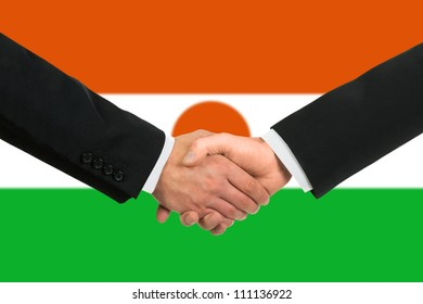 The Niger flag and business handshake