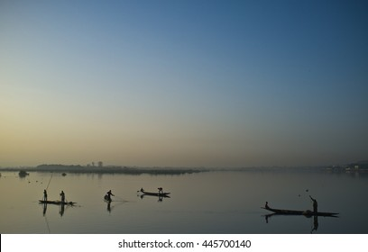 Niger River, Bamako, Mali. Fisherman cast their nets at dawn along Niger River.