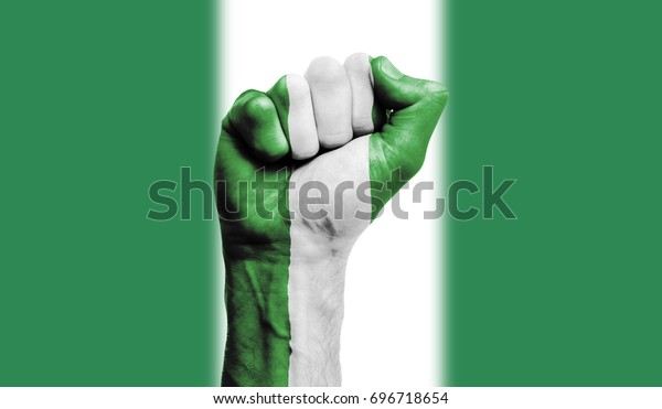 Nigeria flag painted on a clenched fist. Strength, Power, Protest concept