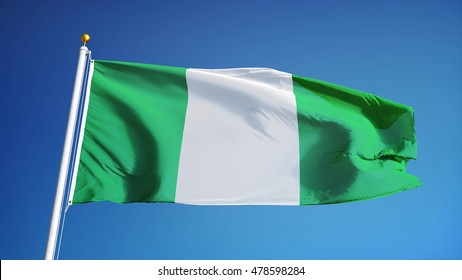 Nigeria flag waving against clean blue sky, close up, isolated with clipping path mask alpha channel transparency