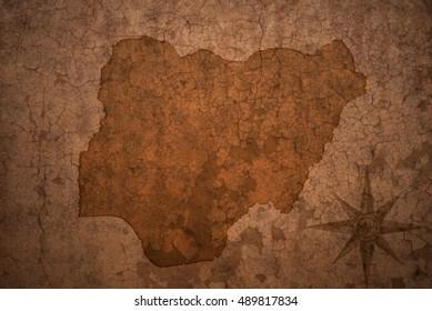 nigeria map on a old vintage crack paper background