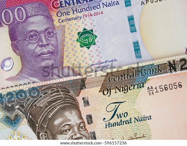 Nigeria money, 100 and 200 naira banknotes closeup, African nigerian currency
